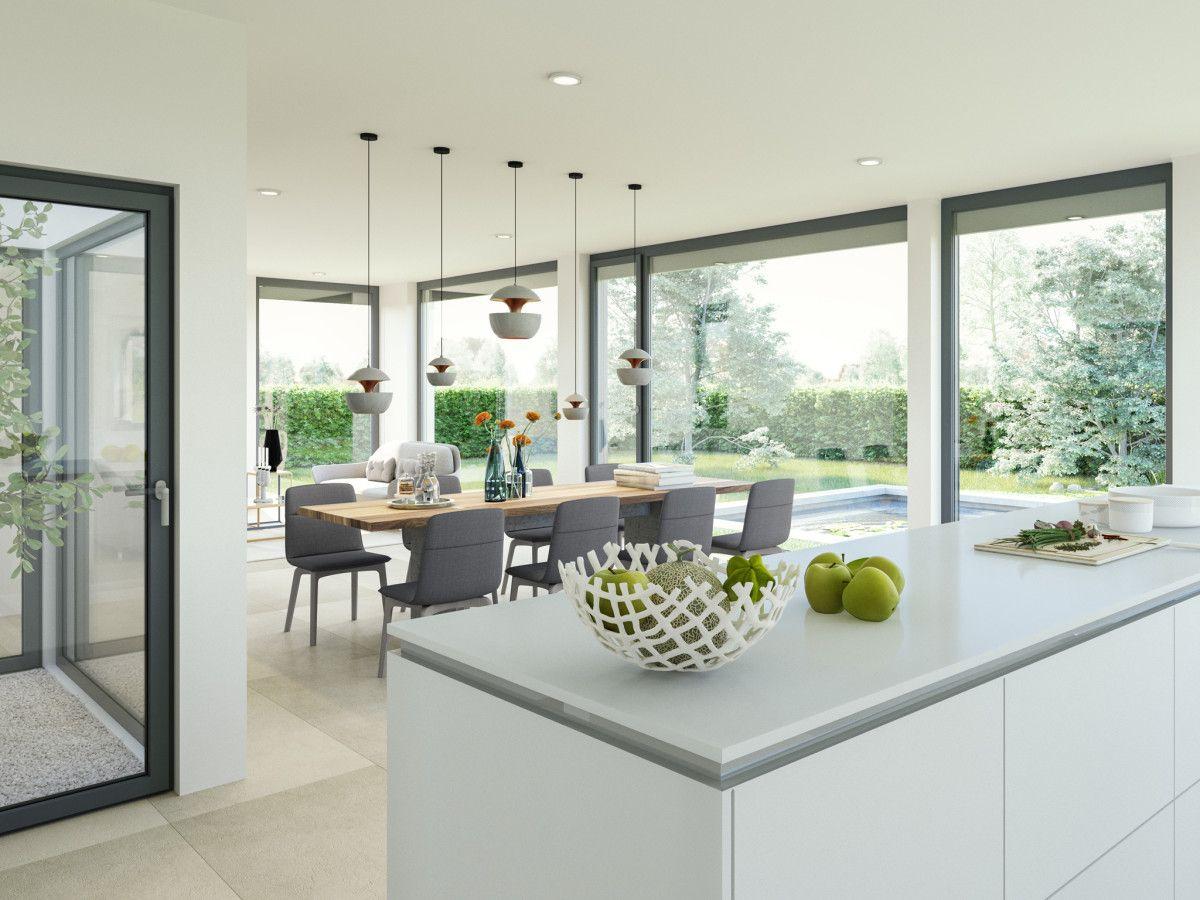 Innenraum mit Atrium offener Küche Esstisch und Wohnzimmer